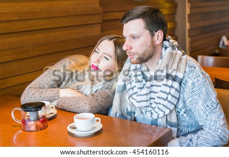 Two people in cafe enjoying the time spending with each other - stock photo