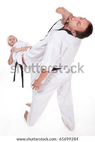 Two people in kimono fight on white background - stock photo