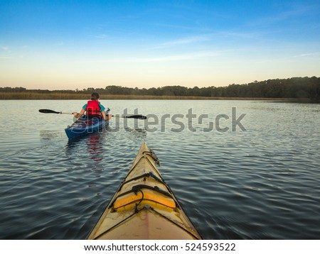 Two people kayaking, view from first kayak.