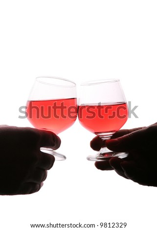 Two people making a toast with glasses against white background
