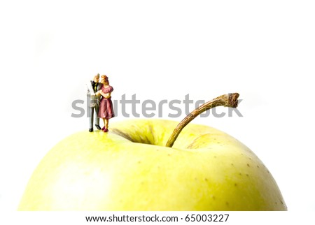 two people on apple - stock photo