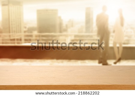 two people on terrace with landscape of city and sunlight  - stock photo