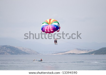 Two people parasailing on the sea - stock photo