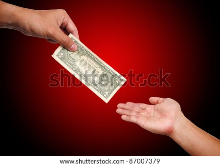 Two people passing  dollar bill from hand to hand - stock photo