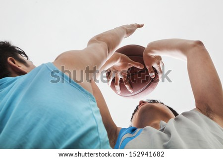 Two people playing basketball, blocking - stock photo