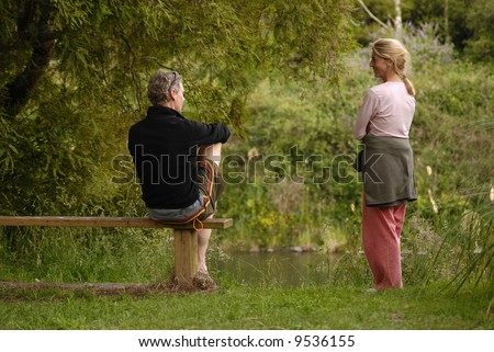 Two people talking outdoors