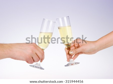 Two people toasting with wine glasses. - stock photo
