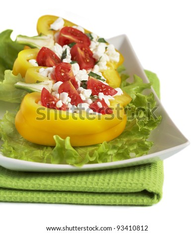 Two pepper halves with cottage cheese and tomatoes