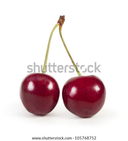 Two perfect sweet cherries solated on a white background.