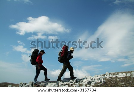 Two person going up along hill - stock photo