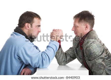 Two persons struggle on hands - stock photo