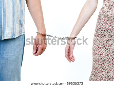 two persons, woman and man  joint with handcuffs - stock photo