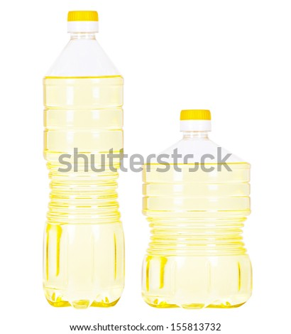 Two pet bottles (tall one and low one) filled with vegetable oil and yellow and white caps isolated on white - stock photo