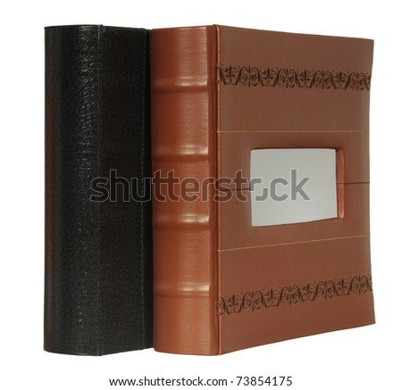 Two photo albums from a skin isolated on a white background