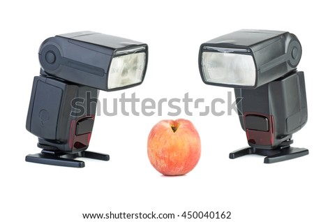 Two photo flashes and peach isolated on white background. Focus point - on fruit. - stock photo