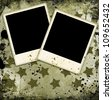 Two photo frames on military grunge background - stock photo