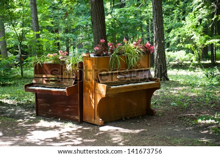 Two pianos in the park - stock photo