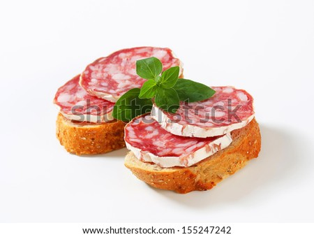two piece of savory with french salami - stock photo