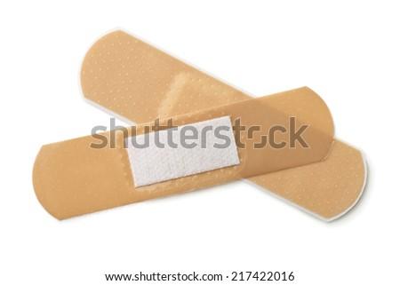 Two pieces of adhesive bandage isolated on white - stock photo