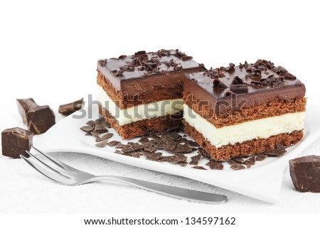 Two pieces of chocolate tart with chocolate pieces - stock photo