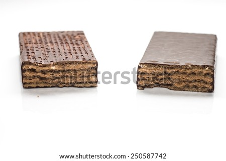 Two pieces of chocolate wafer isolated on white background - stock photo