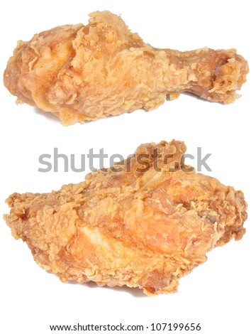 two pieces of fried chicken isolated on a white background - stock photo