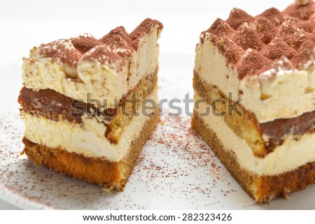 two pieces of sponge cake with whipped cream - stock photo