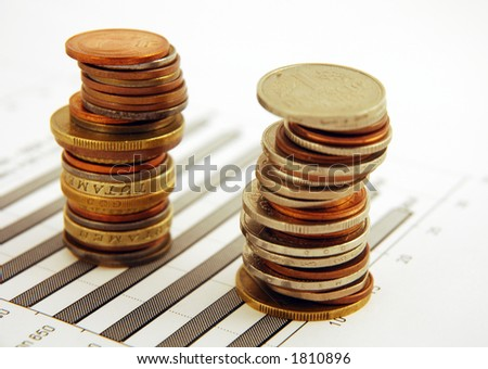 Two piles of money on a chart background - stock photo