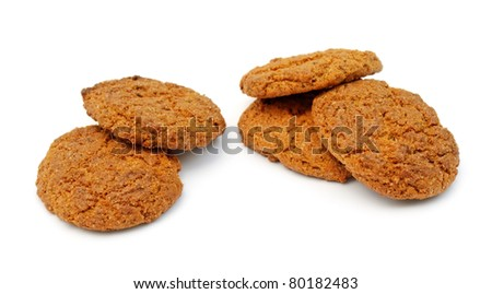 two piles of oatmeal cookies isolated on white