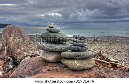 Two piles of stones next to each other - stock photo