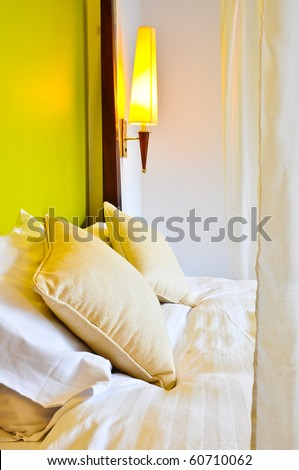 Two pillows on the bed with Lamp - stock photo