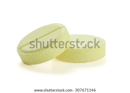 two pills on white