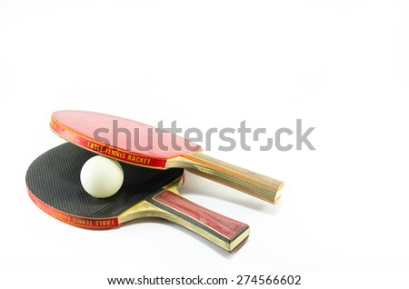 Two ping-pong rackets and a ball isolated on white - stock photo