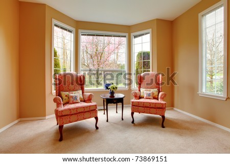Two pink chairs in the living room with cherry blossom - stock photo