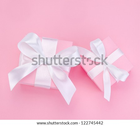 Two Pink Valentines Day gift box tied white satin ribbon bow - stock photo