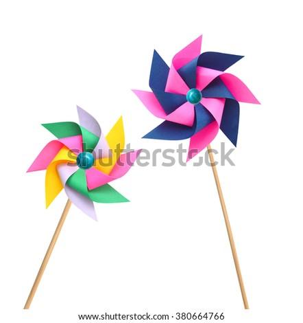 Two pinwheels on white - stock photo