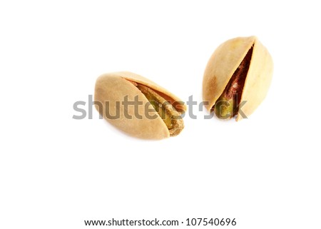 Two pistachios isolated on white background.