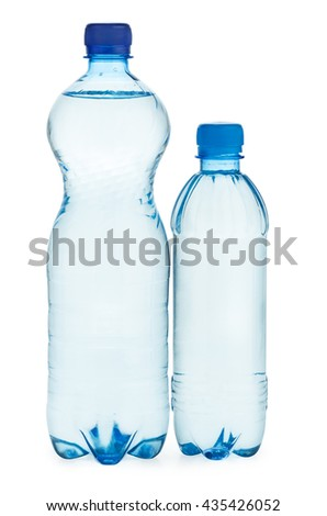 Two plastic bottles with water isolated on white background - stock photo