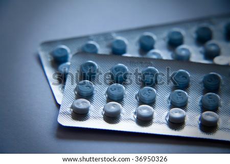 two plates of prescription pills - stock photo