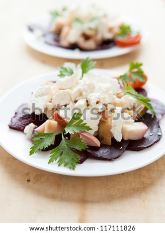 two plates of salad with baked beets, close up