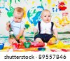 Two playful siblings painting - stock photo