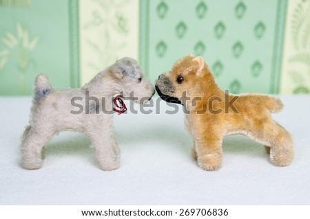 Two plushie dogs standing next to each other - stock photo
