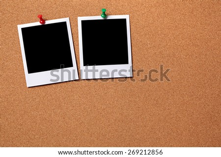 Two polaroid instant photo print, cork background, copy space.   - stock photo
