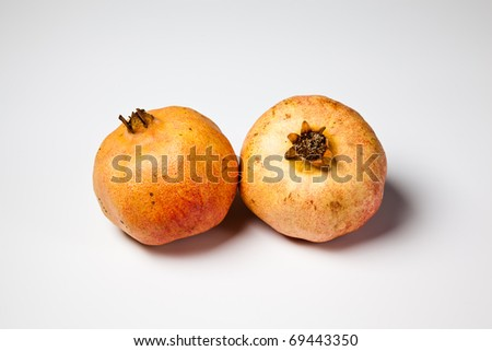 two pomegranate on white background