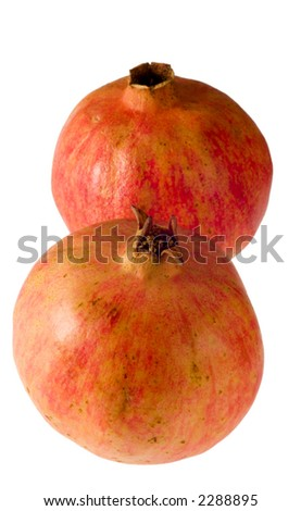 Two pomegranates isolated on white background, vertically disposed - stock photo
