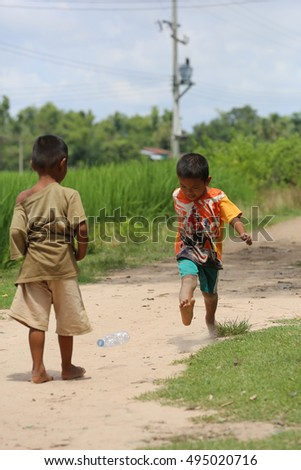 two poor children happy to play at Champasak province, Laos. photo were taken on September 17 2016 on the countryside.