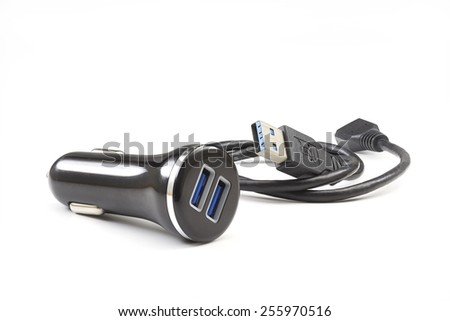 Two port usb car charger with cable on clean background