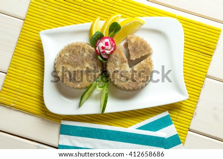 Two portion of pork jelly on white plate - stock photo