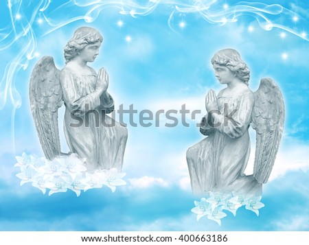 two praying angels with starry sky - stock photo