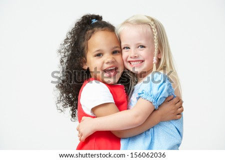 Two Pre School Girls Hugging One Another - stock photo
